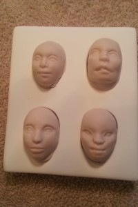 four doll face cabochon mold