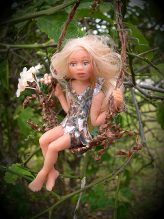 girl-fairy-doll-in-swing.jpg